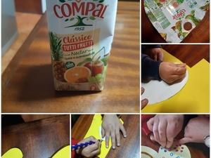 Materiais utilizados (embalagens tetrapack, cartolina, lã, tinta, cola) e fases de elaboração do coração pelo aluno com o apoio da mãe.