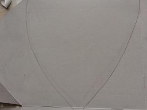 Desenho de um coração num cartão (caixa de um bolo)